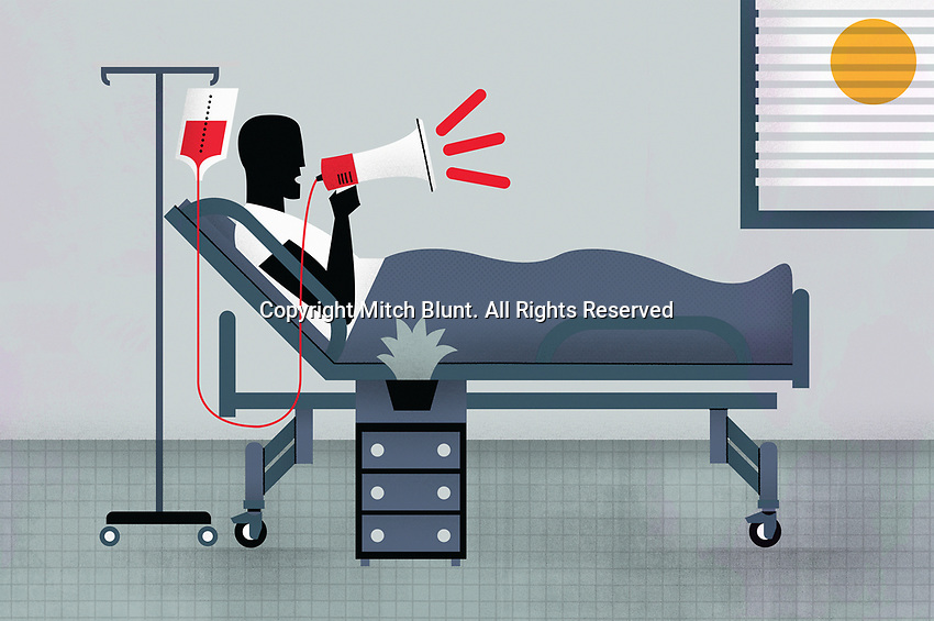 Patient in hospital bed using bullhorn ExclusiveImage