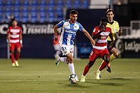 22nd June 2020; Estadio Municipal de Butarque, Madrid, Spain; La Liga Football, Club Deportivo Leganes versus Granada; Oscar Rodriguez (CD Leganes)  outruns the challenge from Azeez of Granada