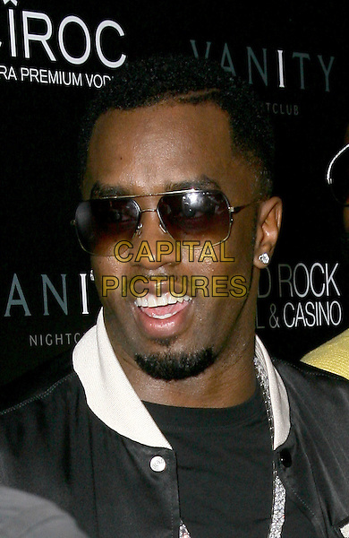 "SEAN ""DIDDY"" COMBS.grand opening of Vanity Nightclub at Hard Rock Hotel and Casino, Las Vegas, Nevada, USA, .2nd January 2010..portrait headshot goatee facial hair earring sunglasses black  white.CAP/ADM/MJT.©MJT/Admedia/Capital Pictures"