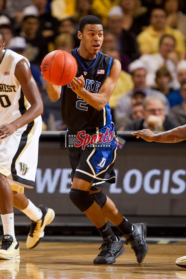Quinn Cook #2 of the Duke Blue Devils passes the ball during first half action against the Wake Forest Demon Deacons at the LJVM Coliseum on February 28, 2012 in Winston-Salem, North Carolina.  The Blue Devils defeated the Demon Deacons 79-71.  (Brian Westerholt / Four Seam Images via AP Images)