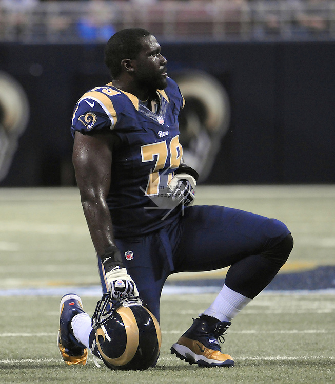 Football - NFL- Washington Redskins at St. Louis Rams.St. Louis Rams tackle Barry Richardson (79) takes a knee on the field during a timeout during first quarter action in the Edward Jones Dome in St. Louis.
