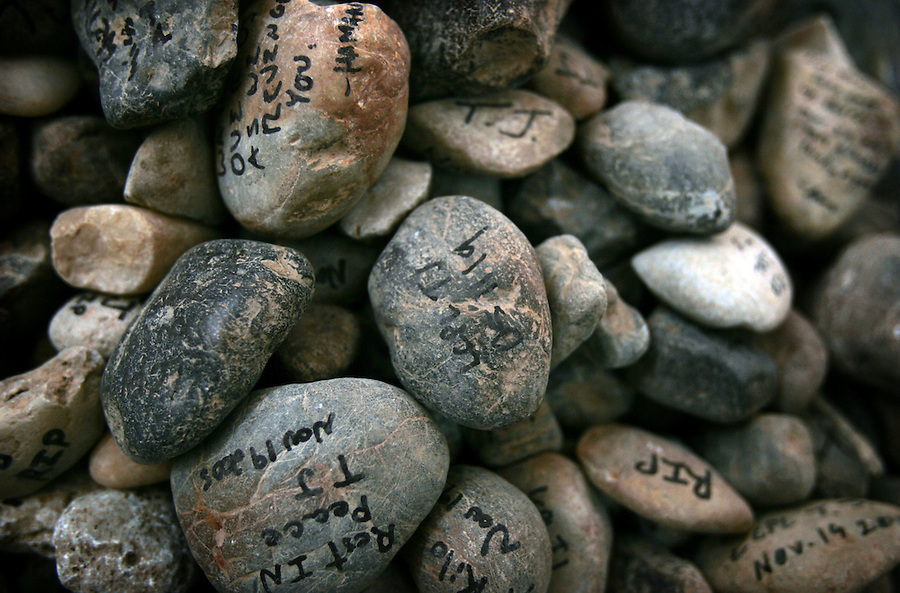 Stones inscribed with messages of farewell form the base of a monument at a memorial service for Lance Corporal Miguel Terrazas killed in action by an IED in Haditha, Iraq on Nov. 19, 2005. The service was held at the company's firm base on Tues. Nov. 29, 2005.