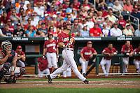 Andrew Benintendi (16) of the Arkansas Razorbacks bats and hits a home run during a game between the Virginia Cavaliers and Arkansas Razorbacks at TD Ameritrade Park on June 13, 2015 in Omaha, Nebraska. (Brace Hemmelgarn/Four Seam Images)