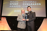Wales Sport Awards 2013<br /> Keith Rollinson receiving his award from Mark Colbourne.<br /> 09.11.13<br /> ©Steve Pope-SPORTINGWALES