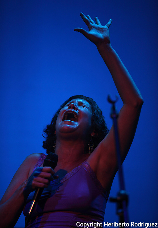 Mexican jazz singer Iraida Noriega sings during a jazz session along with jazz musician Alex Otaola at Mexico City's Fundacion Sebastian's auditorium, March 25, 2011. Photo by Heriberto Rodriguez