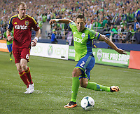 Clint Dempsey, right, of the Seattle Sounders FC battles Nat Borchers of Real Salt Lake for the ball during play at CenturyLink Field in Seattle Friday September 13, 2013. The Sounders won the match 2-0.