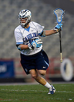 Jimmy Dunster (20) of North Carolina brings the ball into the attacking area during the ACC men's lacrosse tournament semifinals in College Park, MD.  Maryland defeated North Carolina, 13-5.