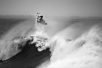 Pro Surfer Ian Walsh pulls a 360 on tropical storm swell at Ruggles point in Newport