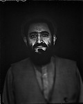 "Abdul Hakim Mujahid, former Taliban envoy to the United Nations, and now First deputy of the high Peace Council, is seen in his office in Kabul, 04 September 2012. This portrait was shot on a 5x4 Linhof Technika IV, circa 1959, and a Schneider Kreuznach 270mm lens, circa 1952, with front tilt, and is part of a series entitled ""Putting an Afghan face on the war."" (John D McHugh)"
