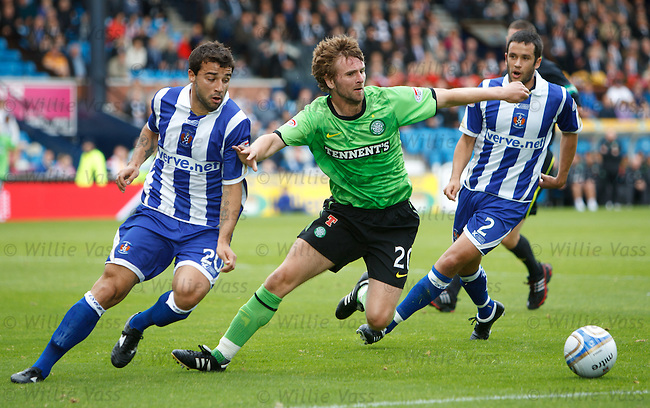 Paddy McCourt turns past Tim Clance and falls injuring his shoulder