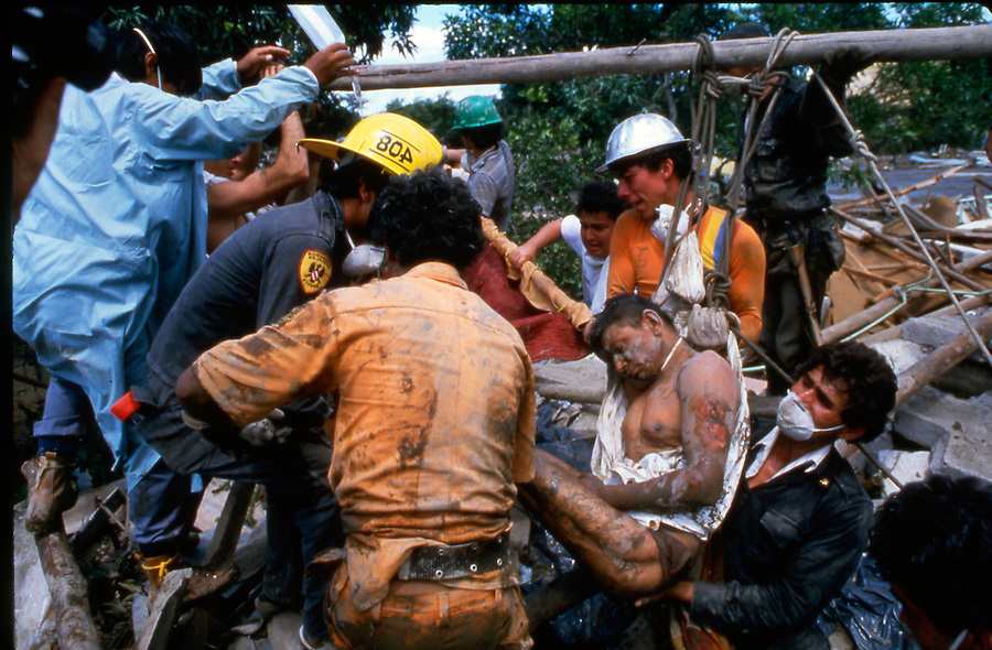 Armero, Colombia where 25,000 were killed when a volcano erupted sending it's snow melt and debris over a vast valley in the coffee growing region five hours from Bogota. This man is finally pulled from the debris after being stuck for four days. Rescue attempts the previous days had failed because the soil with the consistency of pudding would fill in as soon as any was removed from around him and debris had wedged against him under the surface.