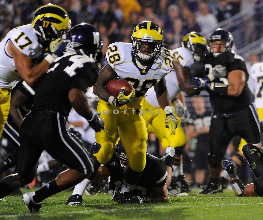 FITZGERALD TOUSSAINT, of the Michigan Wolverines, in action, during Michigan's game against the Northwestern Wildcats on October 8, 2010 at Ryan Field in Evanston, IL. Michigan beat Northwestern 42-24.
