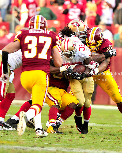 San Francisco 49ers running back Kendall Hunter is tackled by Washington Redskins defenders including Reed Doughty (37), LaRon Landry (30), and Stephen Bowen (72) in the fourth quarter of their game at FedEx Field in Landover, Maryland on Sunday, November 6, 2011.  The 49ers won the game 19 - 11..Credit: Ron Sachs / CNP
