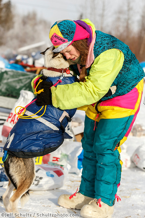 Monica Zappa gives &quot;Shakara&quot; a hug as she drops her because of a sore shoulder at the Tanana checkpoint Wednesday afternoon March 11th during the 2015 Iditarod.<br /> <br /> (C) Jeff Schultz/SchultzPhoto.com - ALL RIGHTS RESERVED<br />  DUPLICATION  PROHIBITED  WITHOUT  PERMISSION