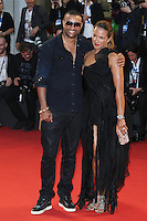 Venice, Italy - September 05: Singer Shaggy and guest attend the 'Good Kill' premiere at Palazzo Del Cinema, during the 71st Venice Film Festival on September 05, 2014 in Venice, Italy. (Photo by Mark Cape/Inside Foto)<br /> Venezia, Italy - September 05: Singer Shaggy and guest presente al premiere di 'Good Kill' al Palazzo Del Cinema, durante del 71st Venice Film Festival. Settembre 05, 2014 Venezia, Italia. (Photo by Mark Cape/Inside Foto)