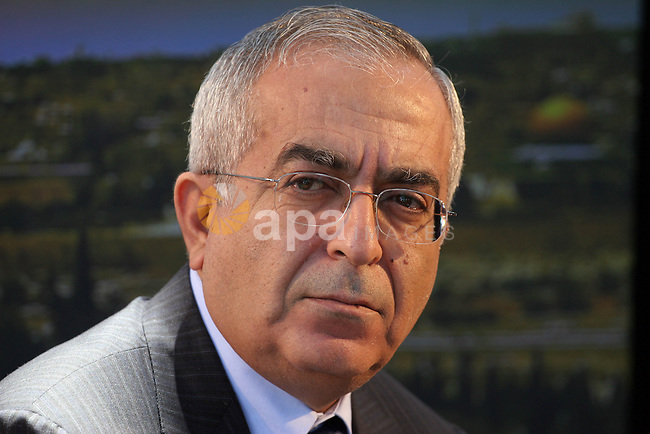 Palestinian prime minister Salam Fayyad attends 'the camp of return' marking the 60th anniversary of the 'Nakba' (catastrophe), in the West Bank city of Ramallah.  As Israel celebrated its 60th birthday today, Palestinians inaugurated a symbolic 'camp of return' to mark refugees' ties to lands lost when the Jewish state was created.