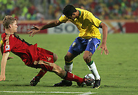 Brazil's Alan Kardec (9) has the ball kicked out from under him by Germany's Florian Jungwirth (4) during the FIFA Under 20 World Cup Quarter-final match at the Cairo International Stadium in Cairo, Egypt, on October 10, 2009. Germany lost 2-1 in overtime play.