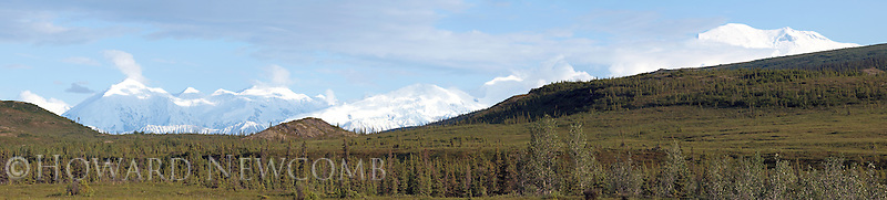Panorama view of a clearing sky over Mt. McKinley and the Alaska Range on a summer evening from a ridge above the Wonder Lake area.  This is a 6 foot long high-resolution composite image showing great detail of the landscape.