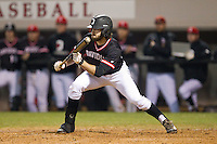 Lee Miller (16) of the Davidson Wildcats squares to bunt against the Wake Forest Demon Deacons at Wilson Field on March 19, 2014 in Davidson, North Carolina.  The Wildcats defeated the Demon Deacons 7-6.  (Brian Westerholt/Four Seam Images)