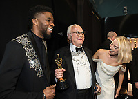Chadwick Boseman, James Ivory, Oscar&reg; winner for adapted screenplay for work on &ldquo;Call Me by Your Name&rdquo; and Margot Robbie pose backstage during the live ABC Telecast of The 90th Oscars&reg; at the Dolby&reg; Theatre in Hollywood, CA on Sunday, March 4, 2018.<br /> *Editorial Use Only*<br /> CAP/PLF/AMPAS<br /> Supplied by Capital Pictures