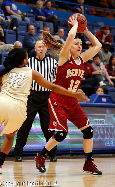 SIOUX FALLS, SD - MARCH 10:  Jacqlyn Poss #12 from Denver looks for a teammate while being pressured by Dawn Luster #32 from IUPUI in the second half of their semifinal game at the 2014 Summit League Basketball Championships Monday at the Sioux Falls Arena(Photo by Dave Eggen/Inertia)