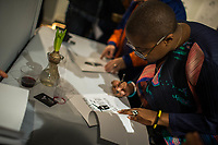 """NEW YORK, NY - MARCH 31: Jazz's singer Cécile McLorin Salvant signs some pieces bought during her expo """"The Adventures of the invisible Woman"""" at RAW space on March 31, 2017 in Harlem, New York. Photo by VIEWpress/Eduardo MunozAlvarez"""