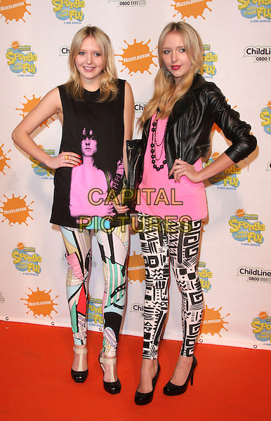 """SAM & AMANDA MARCHANT aka SAMANDA .At the """"Spongebob Squarepants - The Sponge who could Fly"""" Gala performance at the Hammersmith Apollo, London, England, .March 5th 2009.musical full length big brother twins sisters samantha patterned pucci style print leggings mulit-cooured graphic eighties  leather cropped jacket face pink white top sleeveless tunic heels shoes hands on hips .CAP/ROS.©Steve Ross/Capital Pictures"""