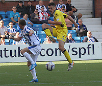 John McGinn shooting past Chris Chantler in the Kilmarnock v St Mirren Scottish Professional Football League Premiership match played at Rugby Park, Kilmarnock on 13.9.14.
