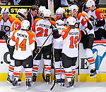 7 December 2009: Philadephia Flyers' newly appointed Head Coach Peter Laviolette strategized with players during a time out against the Montreal Canadiens at the Bell Centre in Montreal, Quebec, Canada. The Canadiens defeated the Flyers 3-1. Mandatory Credit: Ed Wolfstein Photo