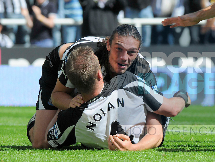 Newcastle's Kevin Nolan is congratulated on his goal by team mate Andy Carroll.