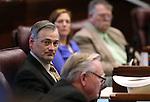 Nevada Sen. James Settelmeyer, R-Minden, works on the Senate floor at the Legislative Building, in Carson City, Nev., on Friday, Feb. 20, 2015. <br /> Photo by Cathleen Allison