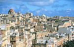 Roof tops appear to be stacked on top of one another above the narrow streets of Valletta, the capital city and major port of the island nation of Malta in the Mediterranean sea