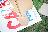 Campaign materials lay on the ground after Republican presidential candidate Dr. Ben Carson met with people at Londonderry Old Home Day in Londonderry, New Hampshire.