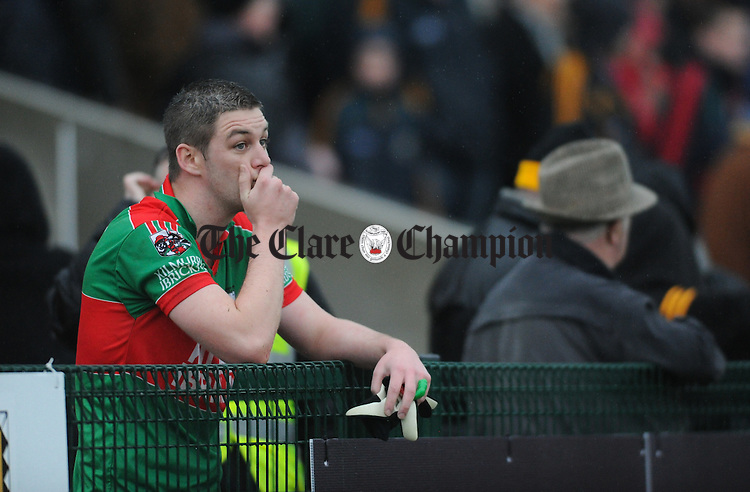 A clearly disappointed Enda Coughlan laments outside the playing area after being sent off during the Munster club semi final against Dr. Croke's at Killarney. Photograph by John Kelly.