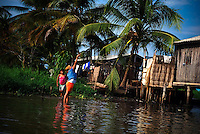 A visit to Sinamica Laggon, in the southern portion of Maracaibo State, Venezuela. This laggon with stilt houses inhabited by 3,000 dwellers  gave the name to Venezuela, since Sanish conquerors relationed this  landscape with Venice, Italy. A majority of residents are indigenous Añu who live in stilt houses on stilts above the tropical  lagoon.