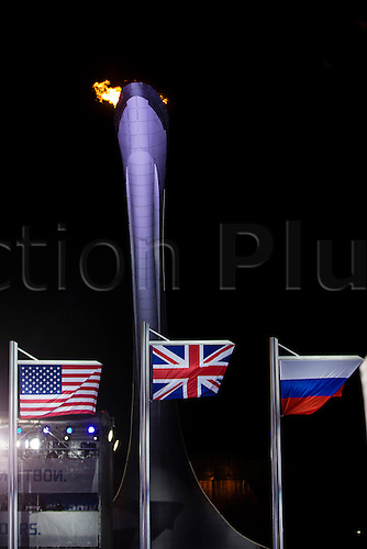 15.02.2014 Sochi, Krasnodar Krai, Russia.   The Union Flag flies high for Lizzy YARNOLD (GBR) in front of the Olympic flame during the Medal Ceremony for the Women's Skeleton at the Sochi Medals Plaza, Coastal Cluster - XXII Olympic Winter Games