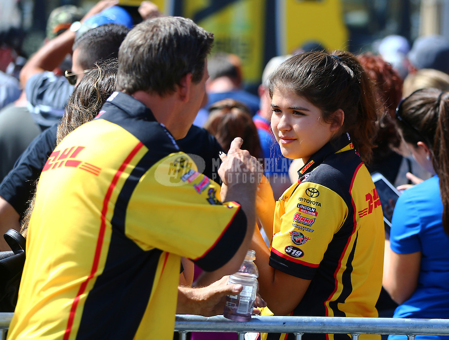 Jul 24, 2016; Morrison, CO, USA; NHRA funny car driver Del Worsham with daughter during the Mile High Nationals at Bandimere Speedway. Mandatory Credit: Mark J. Rebilas-USA TODAY Sports