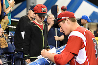 Batavia Muckdogs Ryan Aper (3) signs autographs for a young fan after a game against the State College Spikes on July 3, 2014 at Dwyer Stadium in Batavia, New York.  State College defeated Batavia 7-1.  (Mike Janes/Four Seam Images)