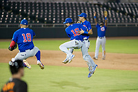 AZL Cubs infielders Luis Hidalgo (18), Carlos Sepulveda (16), Luis Vazquez (1), and Delvin Zinn (21) celebrate after the final out against the AZL Giants on September 7, 2017 at Scottsdale Stadium in Scottsdale, Arizona. AZL Cubs defeated the AZL Giants 13-3 to win the Arizona League Championship Series two games to one. (Zachary Lucy/Four Seam Images)