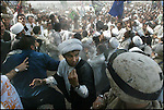 A young cleric loyal to Moqtada al Sadr gestures to a U.S Marine during a volatile demonstration in the holy town of Kufa, south of Najaf.<br /> <br /> Iraq 19 July  2003