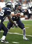 Nevada quarterback Cody Fajardo (17) hands off to running back Stefphon Jefferson (25) during the third quarter of an NCAA college football game in Reno, Nev., on Saturday, Oct. 15, 2011. Nevada won 49-7. (AP Photo/Cathleen Allison)