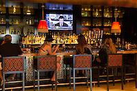 Las Vegas, Nevada.  The Linq Casino.  Patrons at the Bar.