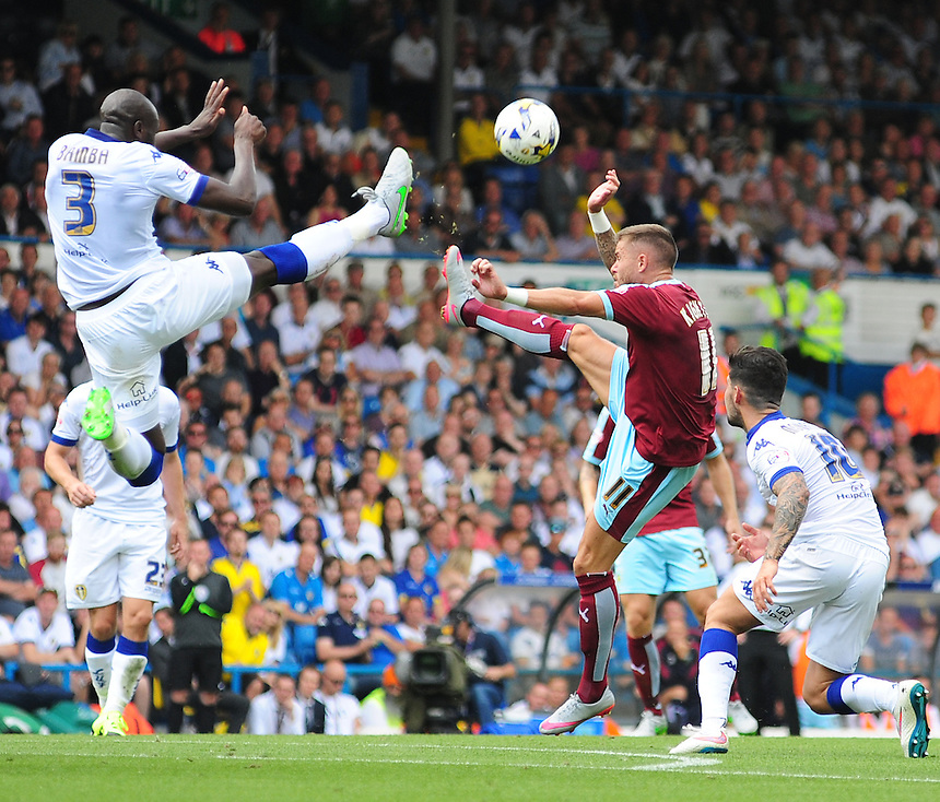 Leeds United's Souleymane Bamba vies for possession with Burnley's Michael Kightly<br /> <br /> Photographer Chris Vaughan/CameraSport<br /> <br /> Football - The Football League Sky Bet Championship - Leeds United  v Burnley - Saturday 8th August 2015 - Elland Road - Beeston - Leeds<br /> <br /> &copy; CameraSport - 43 Linden Ave. Countesthorpe. Leicester. England. LE8 5PG - Tel: +44 (0) 116 277 4147 - admin@camerasport.com - www.camerasport.com
