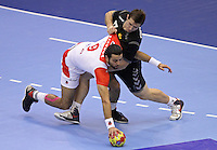 15.01.2013 Granollers, Spain. IHF men's world championship, prelimanary round. Picture show Amine Bannour  and Nemanja Grbovic    in action during game between Tunisia vs Montenegro at Palau d'esports de Granollers