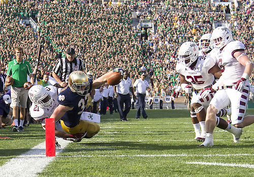 August 31, 2013:  Notre Dame Fighting Irish running back Cam McDaniel (33) makes diving attempt to get into the end zone as Temple defensive back Abdul Smith (21) makes the tackle during NCAA Football game action between the Notre Dame Fighting Irish and the Temple Owls at Notre Dame Stadium in South Bend, Indiana.  Notre Dame defeated Temple 28-6.