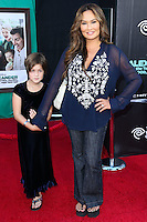 HOLLYWOOD, LOS ANGELES, CA, USA - OCTOBER 06: Audrey Duhinio Janairo, Tia Carrere arrive at the World Premiere Of Disney's 'Alexander And The Terrible, Horrible, No Good, Very Bad Day' held at the El Capitan Theatre on October 6, 2014 in Hollywood, Los Angeles, California, United States. (Photo by Xavier Collin/Celebrity Monitor)
