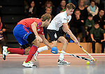 GER - Mannheim, Germany, November 28: During the 1. Bundesliga Sued Herren indoor hockey match between Mannheimer HC (red) and TG Frankenthal (white) on November 28, 2015 at Irma-Roechling-Halle in Mannheim, Germany. Final score 7-7 (HT 3-3). (Photo by Dirk Markgraf / www.265-images.com) *** Local caption ***?Florian Woesch #25 of Mannheimer HC, Johannes Gans #6 of TG Frankenthal