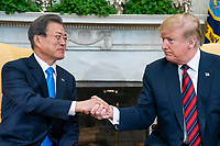 US President Donald J. Trump (R) welcomes Korean President Moon Jae-in (L) to the Oval Office of the White House in Washington, DC, USA, 11 April 2019. President Moon is expected to ask President Trump to reduce sanctions on North Korea in an attempt to jump start nuclear negotiations between North Korea and the US.<br /> Credit: Jim LoScalzo / Pool via CNP/AdMedia
