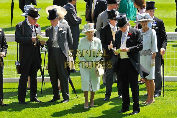 HRH Queen Elizabeth II .At Day One of Royal Ascot, Ascot Racecourse, Ascot, Berkshire, England, UK, June 14th, 2011..full length pale green coat dress hat  gloves cream bag white handbag .CAP/CAS.©Bob Cass/Capital Pictures.