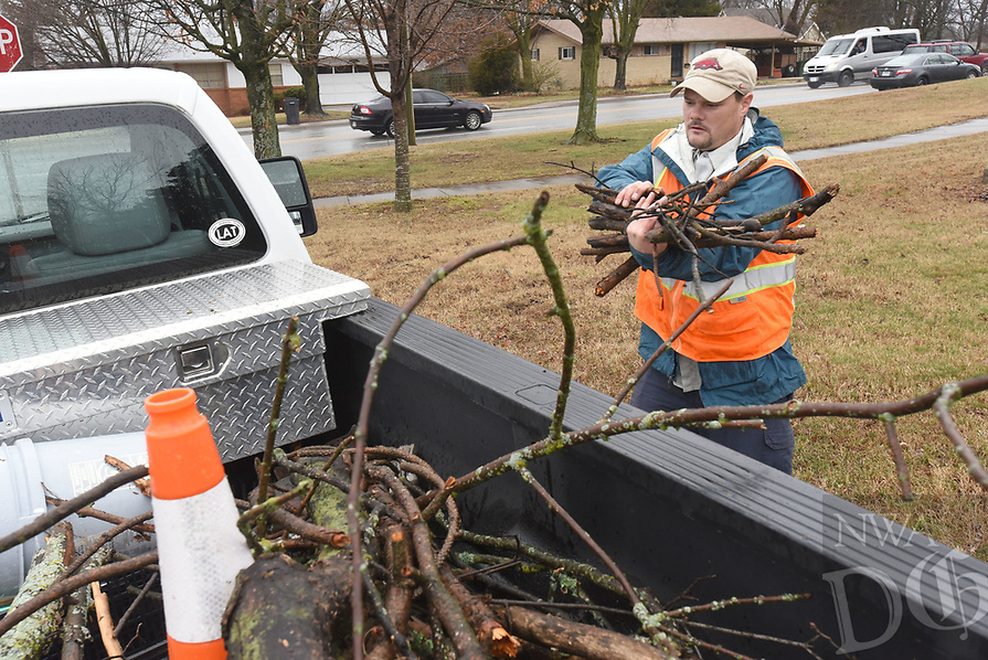 NWA Democrat-Gazette/FLIP PUTTHOFF<br />OUT ON A LIMB<br />Kevin Olson (cq) with Rogers Parks and Recreation Department removes limbs Wednesday Feb. 28 2018 from the lawn at the Rogers Public Library. Rain and wind scattered limbs on some city parks and trails, Olson said.